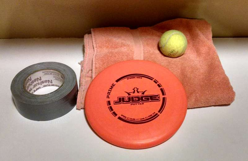 Supplies to Break In A Disc - Disc, Towel, Duct Tape, Tennis Ball