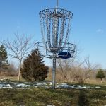 disc golf basket sky putter