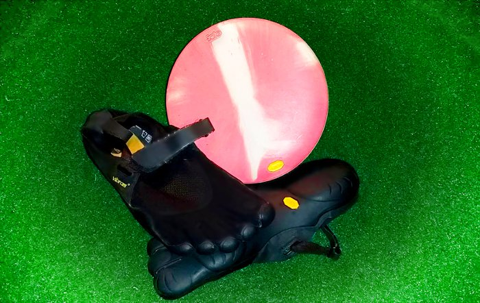 Vibram Sole putter sitting on Vibram Five Finger Shoes