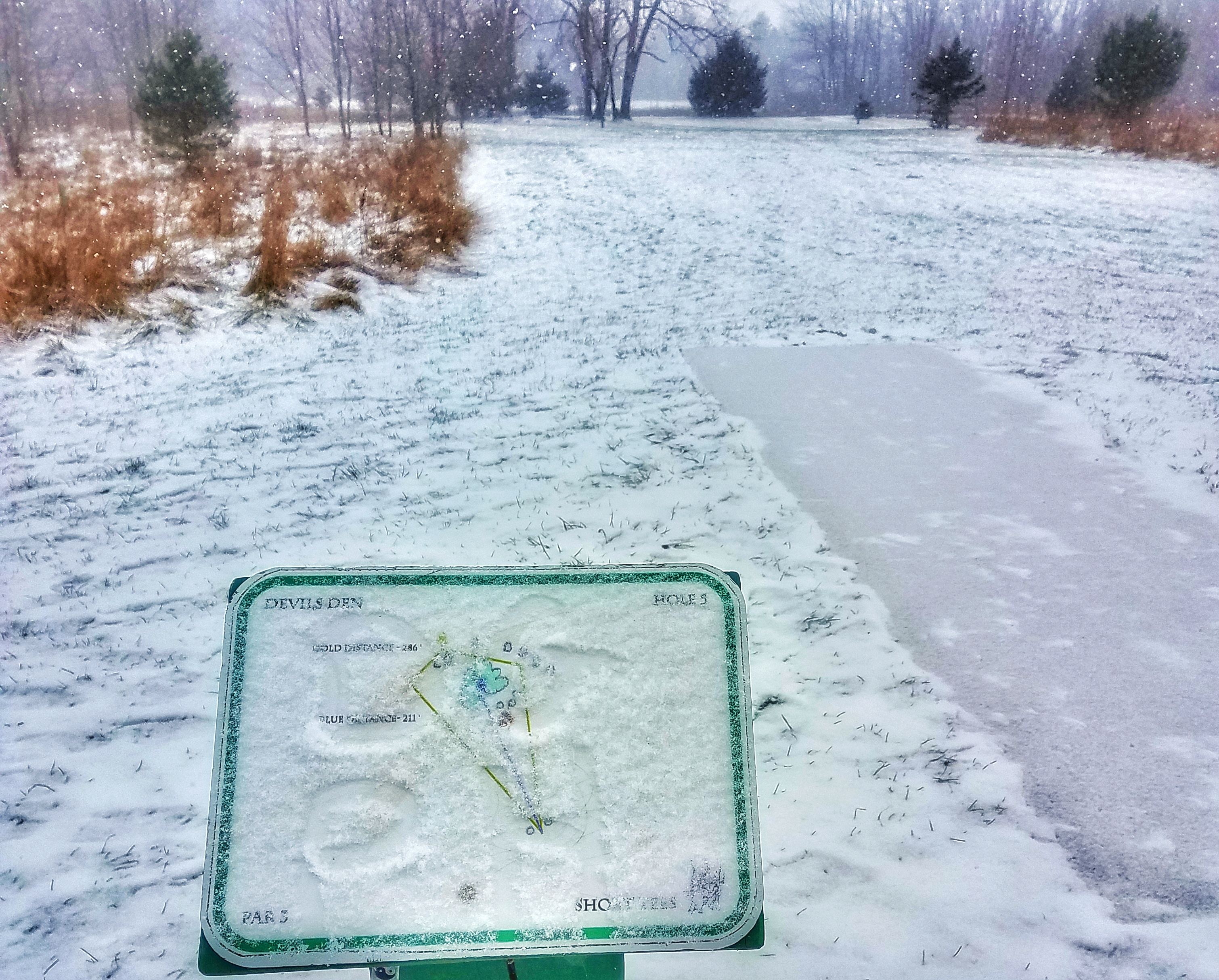 snowy disc golf tee pad